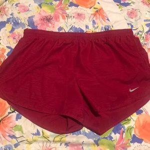 Maroon Nike shorts